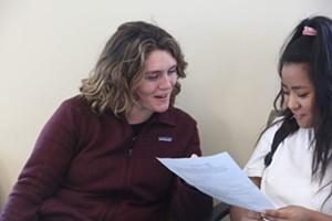 University of Vermont student Aliyah Rosen (left) with Burlington High School sophomore Francika Gurung