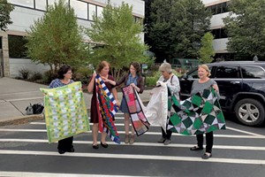 Joyce Irvine, right, with members of the Quilting Queens of National Life Group