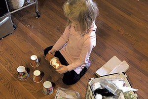 Meredith's daughter explores materials in the family's reuse zone