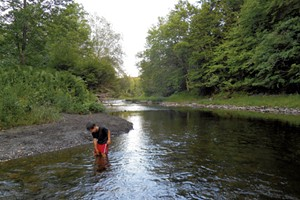 Heather's son Jesse wading in Québec's Tomifobia River in 2014
