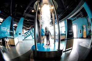 """Chris and daughter Charlotte exploring ECHO'S tornado vortex, part of the """"Awesome Forces"""" exhibit"""