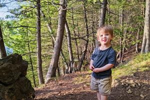 Julie Garwood's toddler, Porter, visiting the trails at Rock Point.