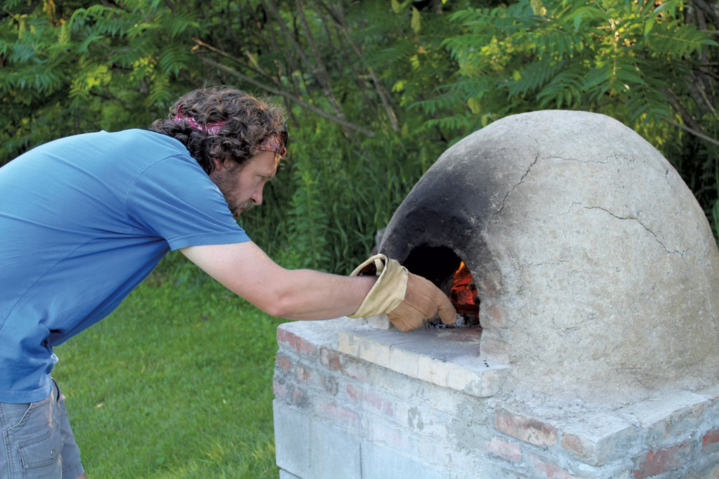 backyard pizza oven by katie titterton click to enlarge kevin stokes the fire courtesy of katie titterton