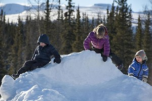 children_play_on_snow_pile_12711723914.jpg