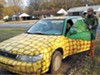A costumed Judith Dierkes and her a-maize-ing car