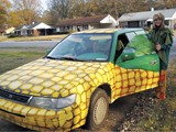 ERICA WALTERS - A costumed Judith Dierkes and her a-maize-ing car
