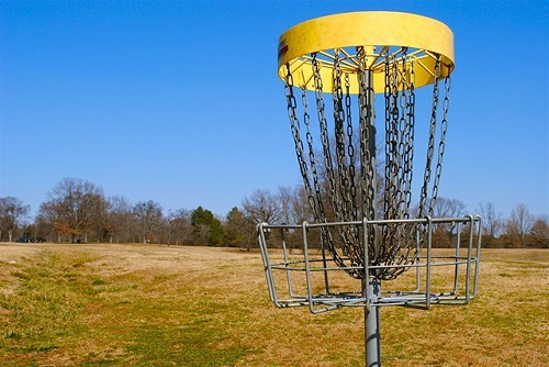 A disc golf basket at Shelby Farms Park.