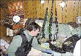 A FALCON III team member inspects guns and marijuana seized near Hohenwald, Tennessee.