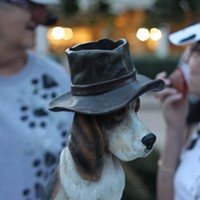 30 Photos of Elvis Fans and Their Elvis Week Shrines A hound dog in a hat.