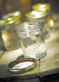 A jar for homemade moonshine, available at the Winery & Brew Shoppe - JUSTIN FOX BURKS
