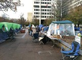 ANDREW CALDWELL - A line of tents buffers occupiers from cold air.