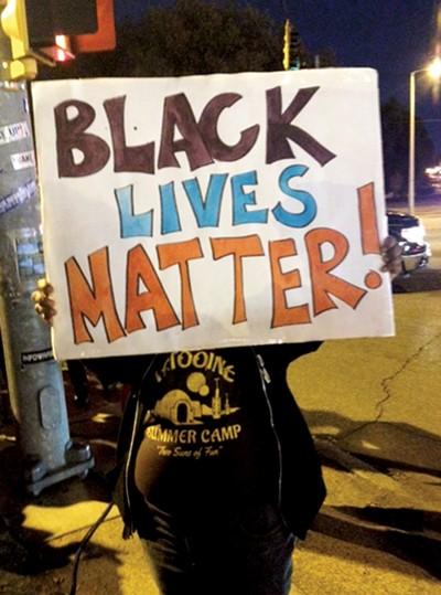 A protester at the Ferguson solidarity demonstration in Memphis last week - LOUIS GOGGANS
