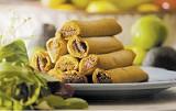 A stack of La Rosa tamales - JUSTIN FOX BURKS