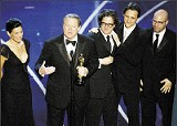(AP PHOTO/MARK J. TERRILL) - Al Gore and the documentary's producers accept an Oscar for An Innocent Truth
