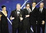 (AP PHOTO/MARK J. TERRILL) - Al Gore and the documentary's producers accept an Oscar for An Innocent Truth