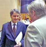 JB - Ambassador Sensoy is greeted by a Rotarian.