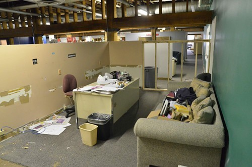 An editorial office pre-rehab:  the sofa now rests in a dumpster.