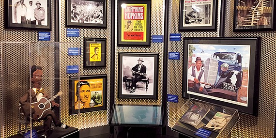 An exhibit at the Blues Hall of Fame featuring memorabilia from Lightning Hopkins and Big Joe Williams.