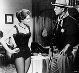 Angie Dickinson and John Wayne