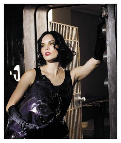 """Armed and Dangerous Laundry black satin dress, from Divine Rags, with purple Tano """"Being Uma"""" bag, from Runway. - JUSTIN FOX BURKS"""