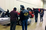 LOUIS GOGGANS - Attendees at the Memphis Black Expo - check out the Corvette show.