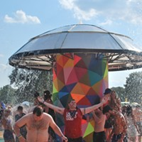 Bonnaroo 2013 Attendees cool off from 80-plus degree temps in the psychedelic mushroom fountain. Bianca Phillips