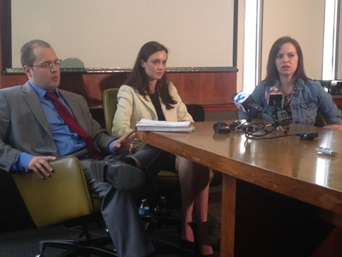 Attorney Daniel Lofton, left, talks to the media with his clients, Meaghan Ybos, center, and Madison Graves, right.