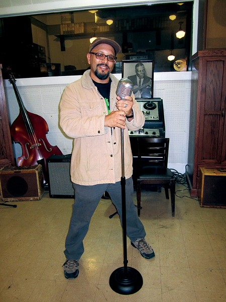 Author Greg Neri holding Cash's microphone at Sun Records