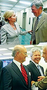 "Back on the scene Monday were zoning lawyers Ron Harkavy (top, with Commissioner Heidi Shafer), and ""Scrappy"" Branan (bottom, left, with Bank of Bartlett president Harold Byrd and Commissioner Terry Roland); - JACKSON BAKER"