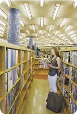 Borrow a book from the Cossitt Branch Public Library. - JUSTIN FOX BURKS