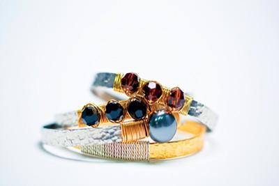 × Bracelets from Sachi, $30-$34