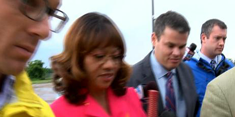 Brooks on the way to jail Thursday night, We know why Channel 5s Jason Mles is smirking. But for Gods sake why is she?