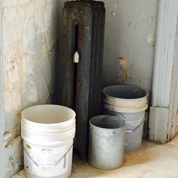 Buckets and a radiator.