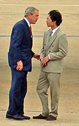 JB - Bush with student Chi Zhang at airport.