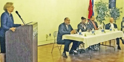 """Candidate Carol Chumney takes the podium at the University of Memphis """"green"""" forum. - JACKSON BAKER"""