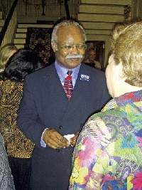 Candidate Herman Morris greets a supporter at a recent political gathering. - JACKSON BAKER