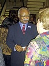 Candidate Herman Morris greets a supporter at a recent political gathering.