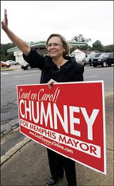 Carol Chumney waves to passing cars at the corner of Park and Mt. Moriah. - JUSTIN FOX BURKS