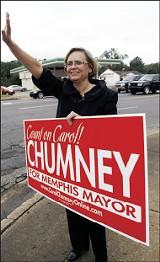 Carol Chumney waves to passing cars at the corner of Park and Mt. Moriah. - JUSTIN FOX BURKS