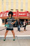 """Chasing fun on Beale is no problem for our models. On Jacqui: M Missoni dress, $695; green Brave necklace, $365; both from James Davis in Laurelwood. Green suede platforms, $39.99; green and gray stripe clutch, $19.99; both from W by Azwell at The Avenue. On Clint: Robert Graham jacket, $700; plum long-sleeve tee by John Varvatos, $125; both from Baer's Den on Poplar. """"Regent"""" jeans by AG, $185; M Missoni scarf, $235; both from James Davis in Laurelwood. His own cap, necklace, and shoes. On Donna: M Missoni scarf, $235, from James Davis in Laurelwood. Plum blouse, $235; black riding pants, $325; both by Rachel Roy. Cream knit shawl by Haute Hippie, $495; Loeffler Randal boots, $450; stone necklace, call for price; all from Oak Hall."""