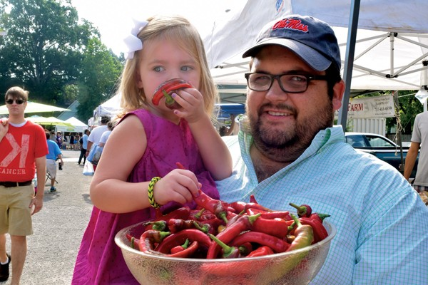 Chef Ryan Trimm and daughter Emma Kate shop for peppers at the Cooper-Young Farmers Market. - JOHN MINERVINI