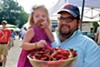 Chef Ryan Trimm and daughter Emma Kate shop for peppers at the Cooper-Young Farmers Market.