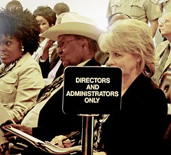 Chism is a stoic observer as the bona fides of his job  is questioned. - JB