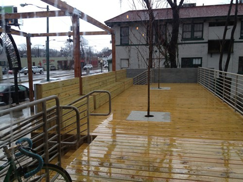 Chiwawas sleek raised patio gets a rain rinse.