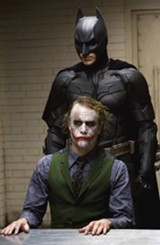 Christian Bale as Batman and Heath Ledger as the Joker