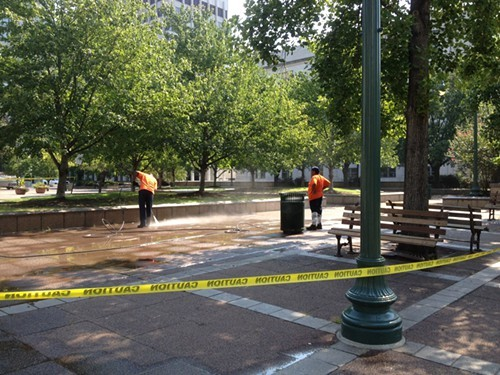 City crews clean up the sidewalk that Occupy has inhabited for nearly one year.