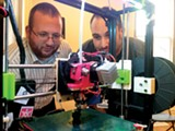 Claudio Donndelinger and Jonathan Wood of the Mid-South Makers show off a 3D printer. - TOBY SELLS