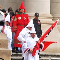 Snapshots from the Klan Rally Coming down the Courthouse steps, these Klansmen lacked hoods but seemed to use shades and face hair for disguise. JB