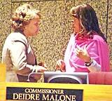 Commissioners Malone and Brooks talk it over. - JB
