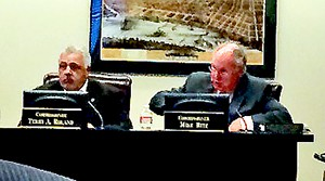 Commissioners Roland and Ritz during debate on the schools capital spending